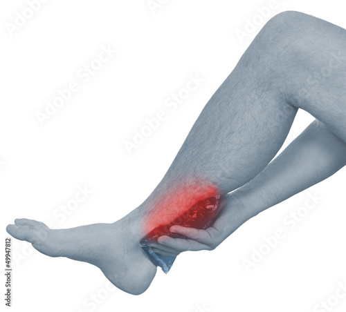 Papiers peints Rouge, noir, blanc Acute pain in a man ankle. Male holding ice pack to spot of ankl