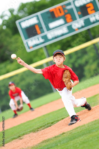 Fotografie, Obraz  Young baseball player pitching the ball