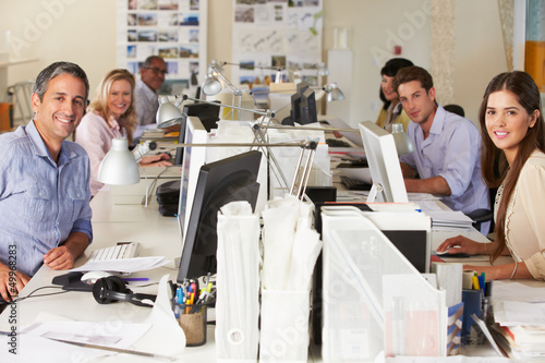 Fotografie, Obraz  Team Working At Desks In Busy Office