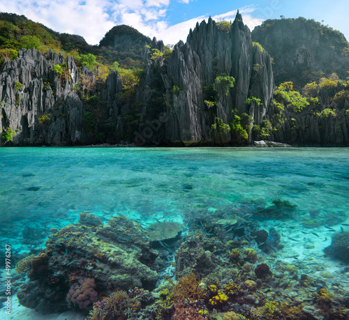 Photo of sharp cliffs and colorful coral reefs in the Philippine