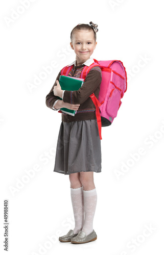 Pupil with suitcase and exercisebooks is ready to go to school Canvas Print