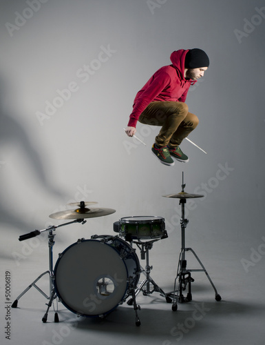 Fotografie, Tablou young drummer jumping while playing
