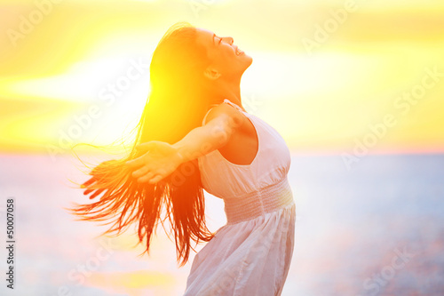 Fotografie, Obraz  Enjoyment - free happy woman enjoying sunset