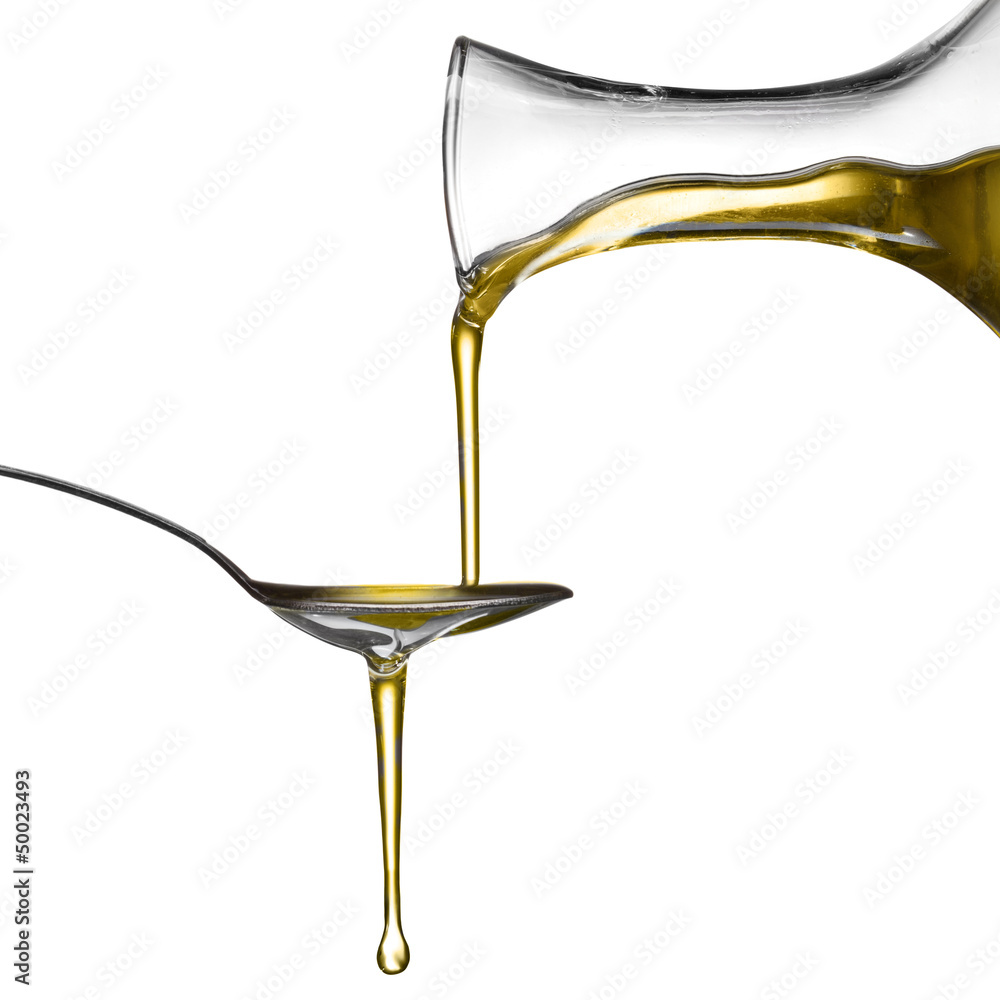 Fototapety, obrazy: Pouring oil on spoon isolated on white