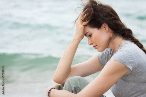Sad and upset woman deep in thought Tablou Canvas