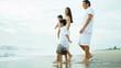 Hispanic loving family spending vacation on beach