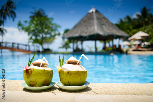 Stampa su Tela Pina colada drink in front of pool
