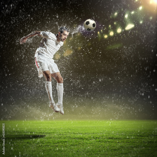 Foto op Plexiglas Voetbal football player striking the ball