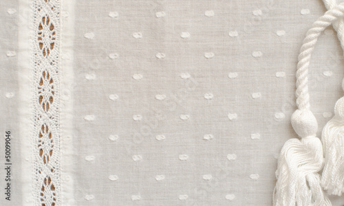 Background of spotted fabric with a strip of lace Canvas Print