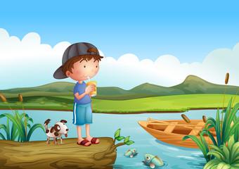 Dječak i pas iznad plutajućeg debla