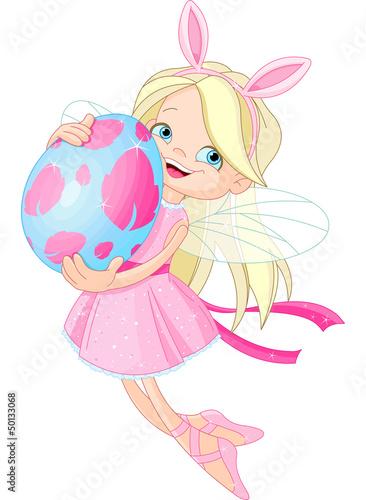 Foto auf Gartenposter Die magische Welt Cute Fairy flying with Easter Egg