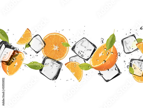 Foto op Aluminium In het ijs Oranges with ice cubes, isolated on white background