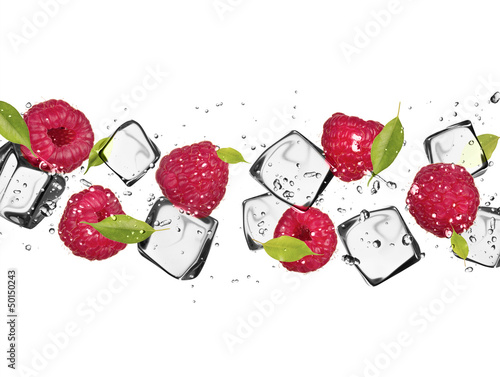 Foto auf Leinwand In dem Eis Raspberries with ice cubes, isolated on white background
