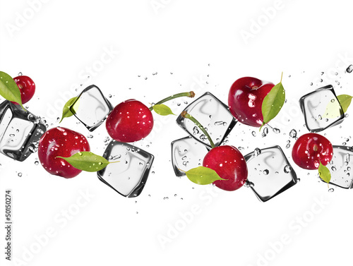 Foto auf Leinwand In dem Eis Fresh cherries with ice cubes, isolated on white background