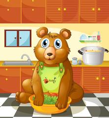 Medvjed koji u kuhinji drži zdjelu s povrćem