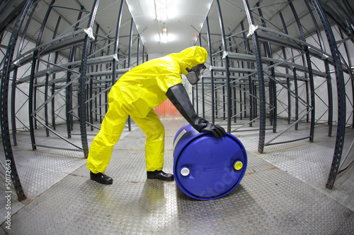 Fotografie, Obraz  fully protected  technician,rolling a barrel wh toxic substance