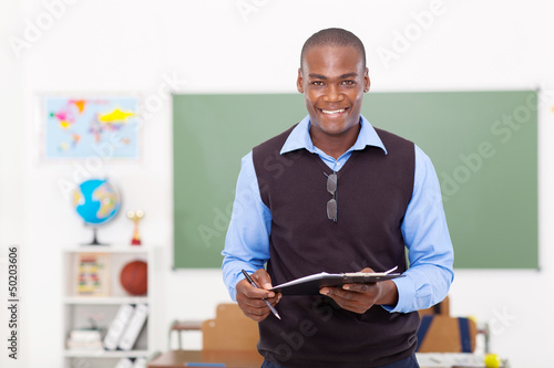 Tablou Canvas male teacher holding a clipboard