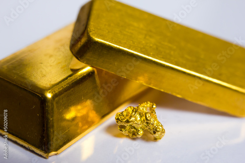 Fotografia, Obraz  Close-up of fine gold ingots and a gold-nugget