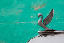 Close-up Of A Hood Ornament Of An Antique Car