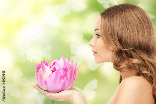 beautiful woman with lotus flower and butterflies