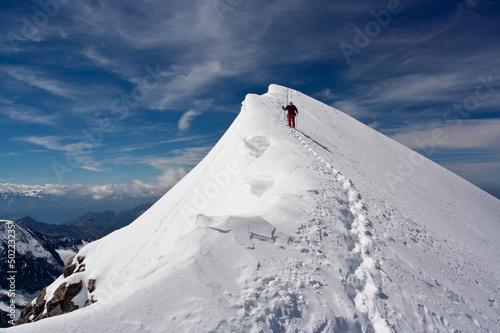 Fotografie, Obraz  Descending climber