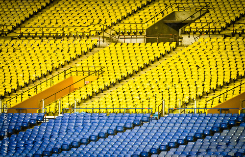 Foto op Plexiglas Stadion Empty Stadium with yellow and blue seats (nobody)