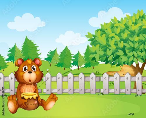 Wall Murals Bears A bear inside the fence holding a pot of honey