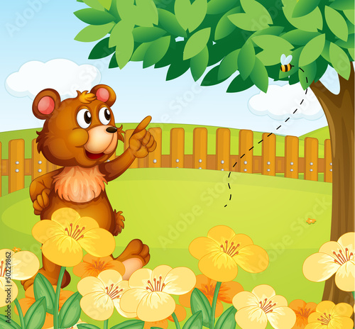 Wall Murals Bears A bear inside the fence pointing a bee