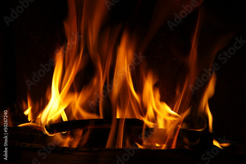Fire in a fireplace, fire flames on a black background #50267240
