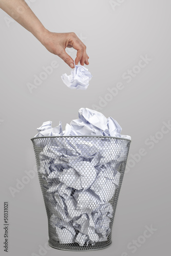 Fototapety, obrazy: Woman hand throwing crumpled paper into a silver trash bin