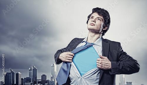 Photo  Young superhero businessman