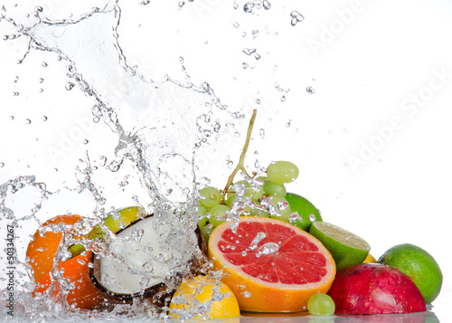 Photo Stands Splashing water Fresh fruits with water splash isolated on white