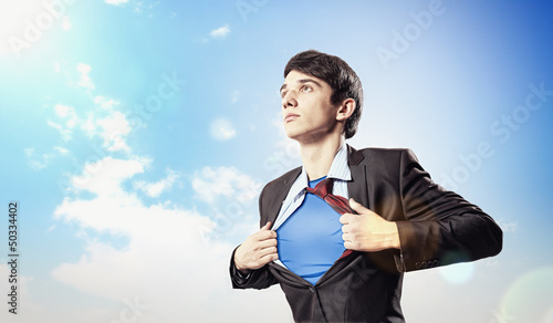 Young superhero businessman Wallpaper Mural