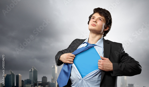 Photo  Young superhero businessman