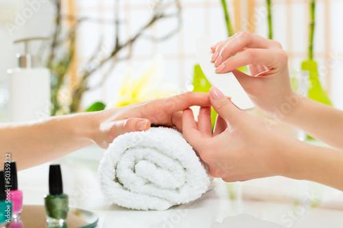 Staande foto Manicure Woman in nail salon receiving manicure