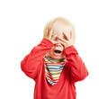 canvas print picture - Kind spielt Verstecken und hält die Augen zu