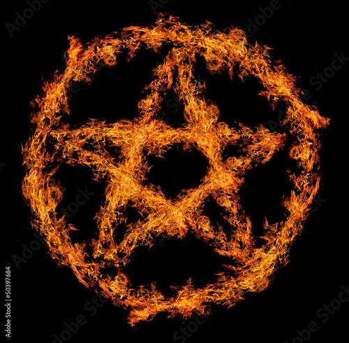 Photo  orange flame pentagram isolated on black