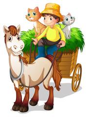 Farmer koji se vozi sa kolicima od slame sa svojim domaćim životinjama