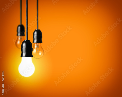 Idea concept on orange background.