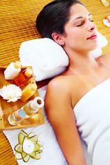 Fototapeta Do Spa Young woman getting massage in spa salon.