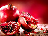 Pomegranates over Red Background. Organic Bio fruits