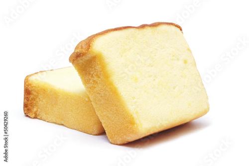 Valokuvatapetti Sliced butter cake on white background