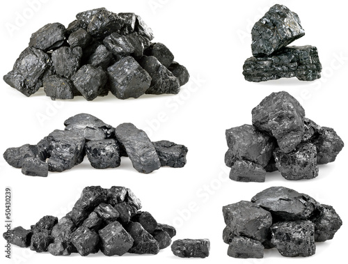 Fotografía Set of piles of coal isolated on white