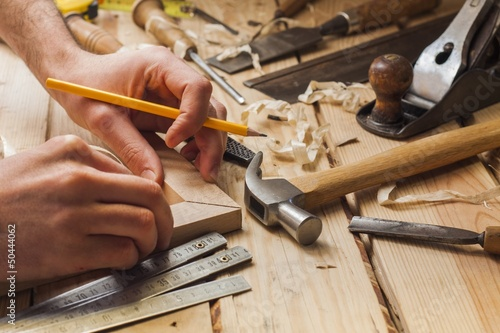 carpenter working,hammer and meter on construction background Fototapet