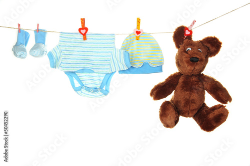 Baby clothes hanging on clothesline, isolated on white #50452290