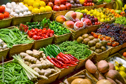 Fototapeta Fruit market with various colorful fresh fruits and vegetables