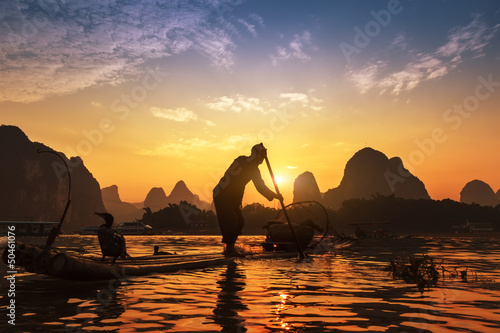 Tuinposter Guilin Boat with cormorants birds, traditional fishing in China use tra
