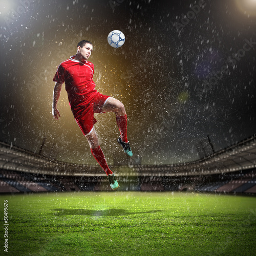 Spoed Foto op Canvas Voetbal football player striking the ball