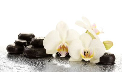 Fototapeta Kamienie Spa stones and orchid flowers, isolated on white.