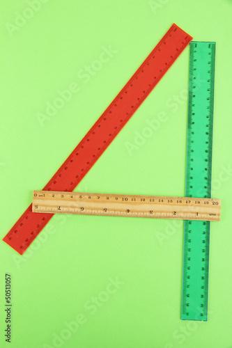 Staande foto Hoogte schaal Rulers on green background